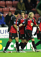 Photo: Paul Greenwood/Sportsbeat Images.<br />Wigan Athletic v Blackburn Rovers. The FA Barclays Premiership. 15/12/2007.<br />Blackburn's Hat-trick scorer Roque Santa Cruz (L) is congratulated by Morten Gamst Pedersen and Robbie Savage