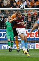 Photo: Steve Bond/Richard Lane Photography. Wolverhampton Wanderers v Aston Villa. Barclays Premiership 2009/10. 24/10/2009. John Carew battles