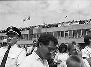 Irish Soccer Team Welcomed Home.   (R81)..1988..19.06.1988..06.19.1988..19th June 1988..After their great success in Germany in Euro 88, the Irish soccer team had a triumphant homecoming. An Taoiseach, Charles Haughey TD and his government were to the forefront of the welcome. Thousands of fans thronged the airport and all the approach roads in the hope of seeing the team. The full squad is as follows..1.GK.Packie Bonner. Celtic.2.DF.Chris Morris. Celtic.3.DF.Chris Hughton  Tottenham Hotspur.4.DF.Mick McCarthy. Celtic.5.DF.Kevin Moran. Manchester United.6.MF.Ronnie Whelan. Liverpool.7.MF.Paul McGrath. Manchester United.8.MF.Ray Houghton. Liverpool.9.FW.John Aldridge. Liverpool.10.FW.Frank Stapleton Derby County.11.MF.Tony Galvin. Sheffield Wednesday.12.FW.Tony Cascarino. Millwall.13.MF.Liam O'Brien. Manchester United.14.FW.David Kelly. Walsall.15.MF.Kevin Sheedy. Everton.16.GK.Gerry Peyton. Bournemouth.17.FW.John Byrne. Le Havre.18.FW.John Sheridan. Leeds United.19.DF.John Anderson. Newcastle United.20.FW.Niall Quinn. Arsenal..Picture shows some of the crowds who turned out to welcome the Irish Team home.