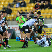 Ben Lam tackled by Hosea Saumaki during the Super Rugby union game between Hurricanes and Sunwolves, played at Westpac Stadium, Wellington, New Zealand on 27 April 2018.   Hurricanes won 43-15.