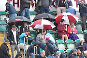 Umbrellas go up in the stands as rain stops play during the Specsavers County Champ Div 1 match between Somerset County Cricket Club and Essex County Cricket Club at the Cooper Associates County Ground, Taunton, United Kingdom on 23 September 2019.
