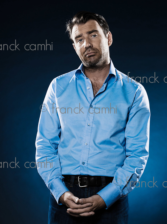 caucasian man unshaven sullen portrait isolated studio on black background