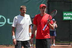 April 11, 2018 - Houston, TX, U.S. - HOUSTON, TX - APRIL 11: Max Mirnyi (BLR) and Philipp Oswald (AUT) look on as a call is reviewed during the Doubles first round of the US Men's Clay Court Championship on April 11, 2018 at River Oaks Country Club in Houston, Texas. (Photo by George Walker/Icon Sportswire) (Credit Image: © George Walker/Icon SMI via ZUMA Press)