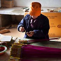 Hunan, Liuyang, Dec. 19..2013 : Liao Jinlian, a worker, assembles  fireckrackers for the Western market in a factory .