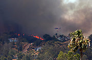May 15, 2014 - Escondido, California, U.S -<br /> <br /> California Wildfires 2014 - Cocos Fire<br /> <br /> People watched as the fire crept over the hill eastward towards Mission Hills High where the Red Cross set up an evacuation center. <br /> ©Exclusivepix