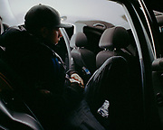 "Young man sits in back of car at local ""Boy Racer"" meet up. Brighton 2013"
