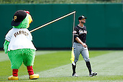 PITTSBURGH, PA - JULY 22: Pittsburgh Pirates mascot Pirate Parrot dangles a fish from his fishing pole while taunting Justin Ruggiano #20 of the Miami Marlins before the game at PNC Park on July 22, 2012 in Pittsburgh, Pennsylvania. The Pirates won 3-0. (Photo by Joe Robbins) *** Local Caption *** Justin Ruggiano