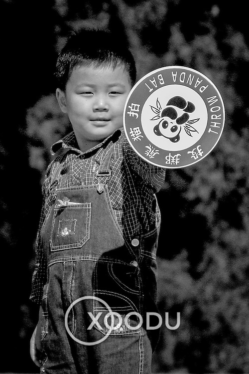 Little boy with Panda toy, Beijing, China (May 2004)