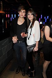 DOUGLAS BOOTH and SIAN SIDAWAY at the Tatler Little Black Book Party held at Chinawhite, 4 Winsley Street, London on 20th November 2009.