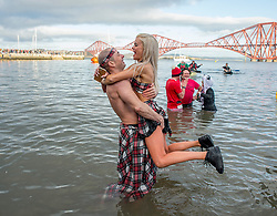 Thousands of people, many in fancy dress, took part in the annual Loony Dook New Years swim in the Firth of Forth at Queensferry in the shadow of the iconic Forth Bridges today.<br /> <br /> © Dave Johnston / EEm