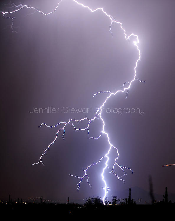 July. 11, 2012; Scottsdale, AZ, USA; Lightning strikes in the desert of Arizona. Mandatory Credit: Jennifer Stewart