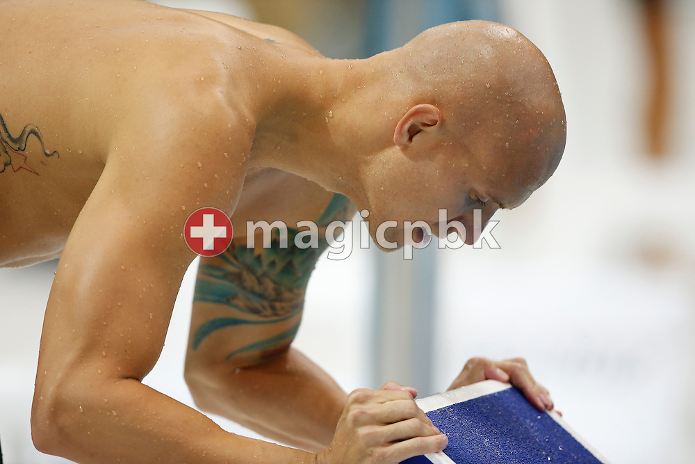 Brent Hayden of Canada kisses the start block after finishing third in the men's 100m Freestyle Final during the Swimming competition held at the Aquatics Center during the London 2012 Olympic Games in London, Great Britain, Wednesday, August 1, 2012. (Photo by Patrick B. Kraemer / MAGICPBK)
