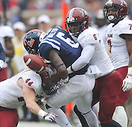 Mississippi running back Jaylen Walton (6) fumbles as he is tackled by Troy defensive end Tyler Roberts  (44) and Troy cornerback Femi Odaibo (6) at Vaught-Hemingway Stadium in Oxford, Miss. on Saturday, November 16, 2013. (AP Photo/Oxford Eagle, Bruce Newman)