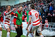 Doncaster Rovers forward John Marquis (22) celebrates his goal with team mates 2-1 during the EFL Sky Bet League 1 match between Doncaster Rovers and Peterborough United at the Keepmoat Stadium, Doncaster, England on 9 February 2019.