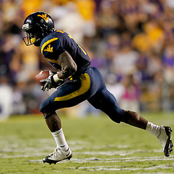Sep 25, 2010; Baton Rouge, LA, USA; West Virginia Mountaineers running back Noel Devine (7) runs against the LSU Tigers during the second half at Tiger Stadium. LSU defeated West Virginia 20-14.  Mandatory Credit: Derick E. Hingle