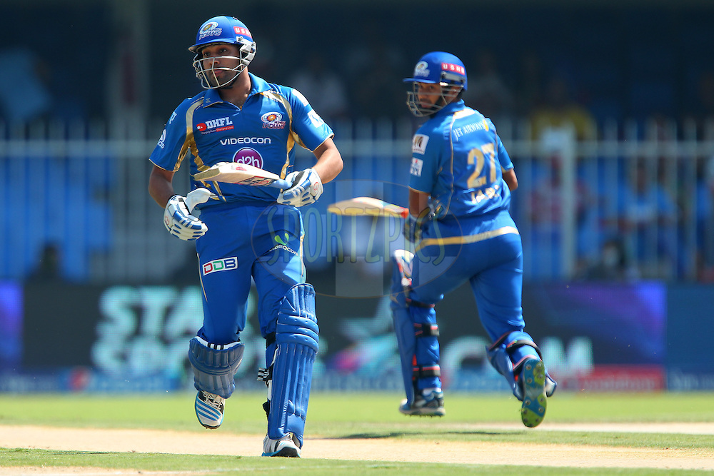 Rohit Sharma captain of of the Mumbai Indians and Aditya Tare of the Mumbai Indians make the run during match 16 of the Pepsi Indian Premier League 2014 between the Delhi Daredevils and the Mumbai Indians held at the Sharjah Cricket Stadium, Sharjah, United Arab Emirates on the 27th April 2014<br /> <br /> Photo by Ron Gaunt / IPL / SPORTZPICS