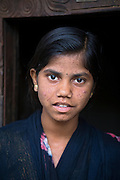 Tabasum Khatun, 14, is potrayied in front of the entrance to her home in Algunda village, pop. 1000, Giridih District, rural Jharkhand, India.