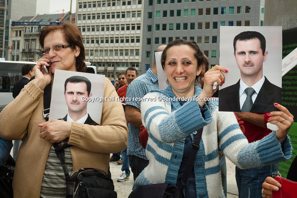 BrusselsBelgium, May 20 2011: a small group of Belgian Syrians protest againts European intervenance in Syria, and are in favour of president Bashar al-Assad. Holding his picture in front of the European committee, demonstrating.Women demonstrate separated of the men. Woman holding a picture of president Assad of Syria.©REPORTERS/SANDERDEWILDE
