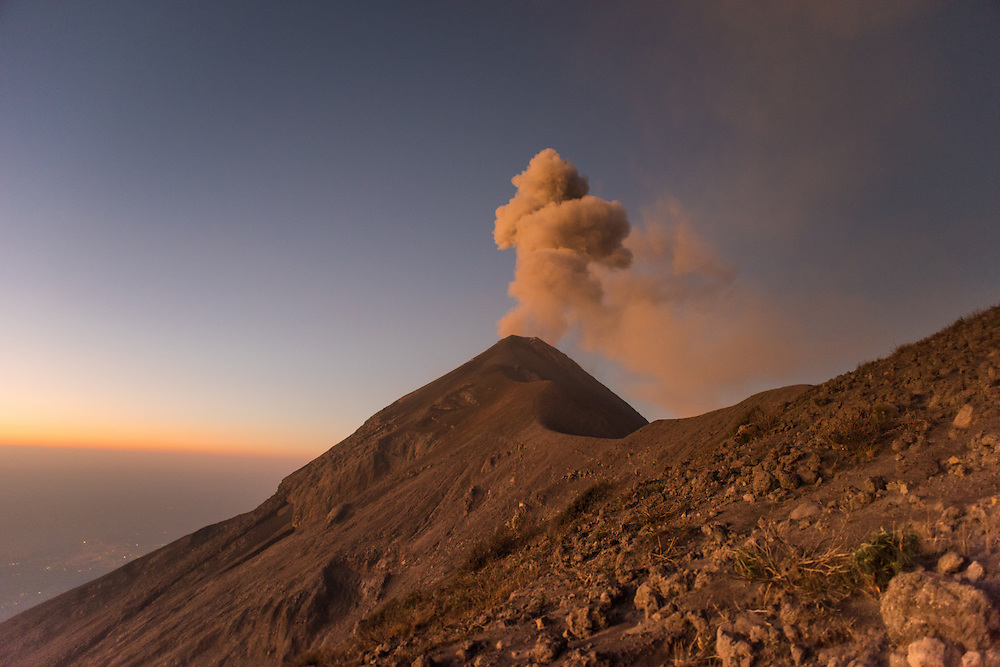 Volcan Fuego explodes at sunrise, gasping out cloud of ash, Volcan Fuego, Guatemala.