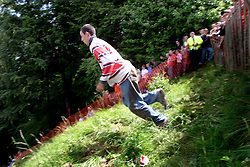 UK ENGLAND COOPERS HILL 31MAY04 - Contestant Chris Anderson (16) throws himselvf off the top of a steep 200-metre slope in pursuit of a 7-pound Cloucester Cheese. The cheese rolling is one of the oldest customs to have survived some saying, for hundreds of years, even pre-Roman times. The ceremony is reported to.have taken place originally at midsummer and to have been moved to Whitsun in early Saxon times. Some say it is a relic of an old heathen festival to celebrate the return of spring and.others say, when held in midsummer, it represented the waning of the sun as summer reached its height, but no one knows for sure....jre/Photo by Jiri Rezac..© Jiri Rezac 2004..Contact: +44 (0) 7050 110 417.Mobile:  +44 (0) 7801 337 683.Office:  +44 (0) 20 8968 9635..Email:   jiri@jirirezac.com.Web:     www.jirirezac.com
