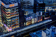 Tokyo, March 29 2015 - Ginza and the Shinkansen bullet train by night as seen from above.