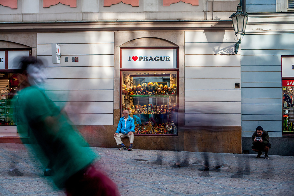 """A street perfomer dancing in-front of a souvenir shop called """"I love Prague"""" at the street """"Na Mustku"""" located on the lower end of Wenceslas Square in Prague."""