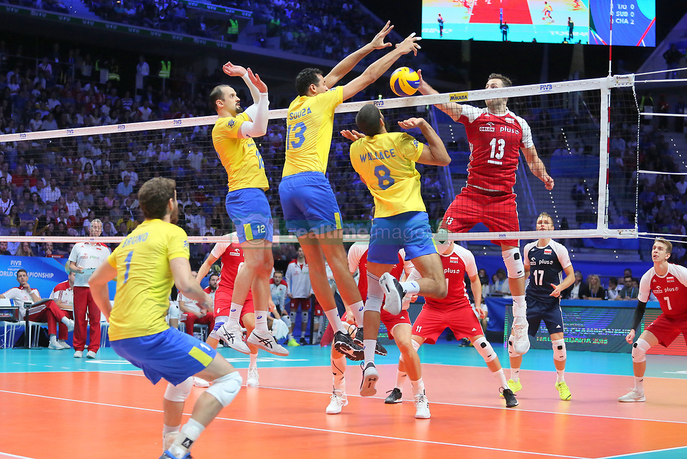 September 30, 2018 - Turin, Piedmont, Italy - Michal Kubiak of Poland in action against Wallace De Souza(R), Maurcio Souza(C), Luiz Felipe Marques Fonteles (L) of Brazil  and during the final match between Brazil and Poland for the FIVB Men's World Championship 2018 at Pala Alpitour in Turin, Italy, on 30 September 2018. Poland won 3: 0 and it is confirmed world champion. (Credit Image: © Massimiliano Ferraro/NurPhoto/ZUMA Press)