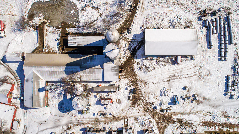 High angle view of working dairy farm in action on a snowy day, Taneytown, Maryland