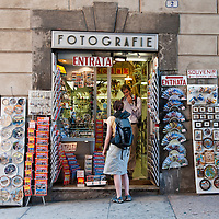 Tourist buying souvenirs at a shop in Verona.Verona is a city in Veneton, Northern Italy home to approx. 265,000 inhabitants and one of the seven provincial capitals of the region. Verona has Roman origins and  derived importance from being at the intersection of many roads. It is world famous for the Arena and its Opera....***Agreed Fee's Apply To All Image Use***.Marco Secchi /Xianpix. tel +44 (0) 207 1939846. e-mail ms@msecchi.com .www.marcosecchi.com