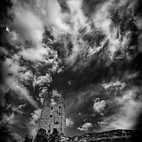 Dunstanburgh castle in the north of England under a stormy sky