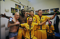 Football - 2016 / 2017 FA Cup - Fourth Round: Sutton United vs. Leeds United<br /> <br /> l-r : Sutton players, Nicky Bailey , Kevin Amankwaaah, Max Biamou ,Jamie Collins and Craig Eastmond (front)  lead the celebrations in the dressing room at Gander Green Lane.<br /> <br /> COLORSPORT/ANDREW COWIE