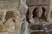 Capital and an atlante holding an entablature like Atlas holding the celestial vault, in the galleries of the North nave of the Abbatiale Sainte-Foy de Conques or Abbey-church of Saint-Foy, Conques, Aveyron, Midi-Pyrenees, France, a Romanesque abbey church begun 1050 under abbot Odolric to house the remains of St Foy, a 4th century female martyr. The church is on the pilgrimage route to Santiago da Compostela, and is listed as a historic monument and a UNESCO World Heritage Site. Picture by Manuel Cohen