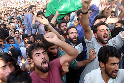 July 30, 2017 - Anantnag, Jammu and Kashmir, India - Kashmiri Villager's Shouted Anti- Indian and Pro-Freedom Slogans during the funeral of a slain kashmiri Rebel Shabir Ahmad Mir @ Zeeshan looks at Mahind Bijbehara village of Anantnag District, 68 Km from Srinagar, Mir was killed along with Another associate Shakir Ah in a gunfight with forces in Tahab Pulwama. (Credit Image: © Muneeb Ul Islam/Pacific Press via ZUMA Wire)