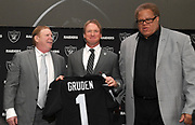 Jan 9, 2018; Alameda, CA, USA; Jon Gruden (center) poses with Oakland Raiders owner Mark Davis (left) and general manager Reggie McKenzie after being introduced as head coach at a press conference at the Raiders headquarters.