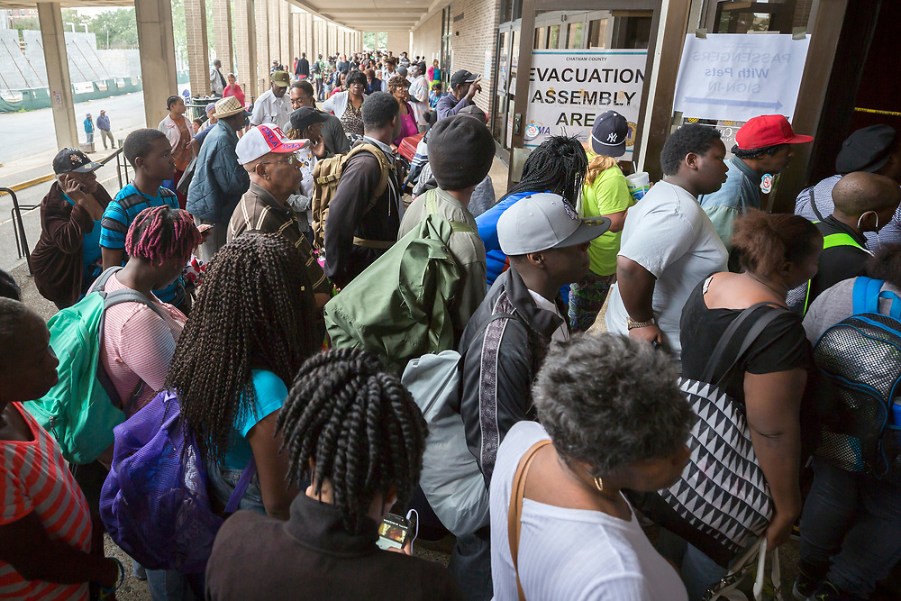 Hundreds of Savannah residents waiting in line at the Savannah Civic Center before evacuating from the path of Hurricane Irma, Saturday, Sept., 9, 2017 in Savannah, Ga. (AP Photo/Stephen B. Morton)