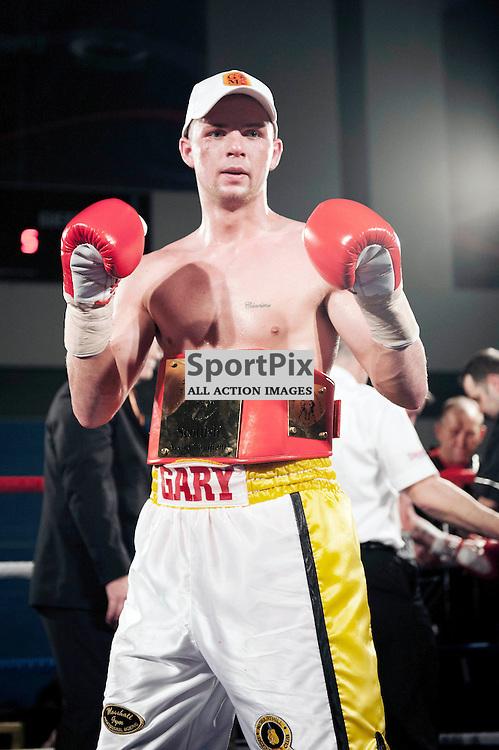 Gary McCallum beats Paul Allison to win the Scottish Middleweight Title. Gary McCallum v Paul Allison, Scottish Middleweight Championship Fight, Ravenscraig Sports Facility, Friday 8 March 2013 ANGIE ISAC | StockPix.eu