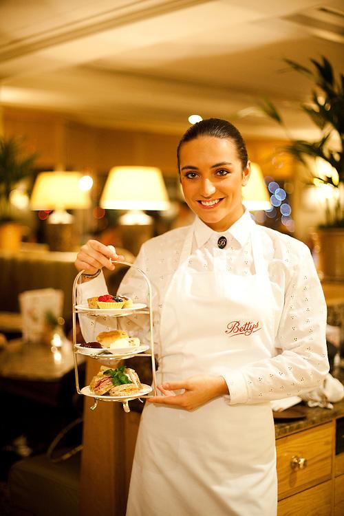Waitress Malgorzatha Rownicka poses in Betty's Tea Rooms, Harogate, Yorkshire