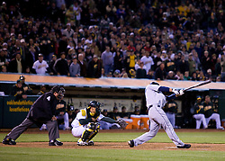 April 5, 2010; Oakland, CA, USA;  Seattle Mariners first baseman Casey Kotchman (13) hits a two RBI single off of Oakland Athletics relief pitcher Andrew Bailey (not pictured) during the ninth inning at Oakland-Alameda County Coliseum. Seattle defeated Oakland 5-3.