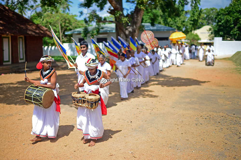 Religious parade at the Sri Maha Bodhi Temple in Anuradhapura. <br /> <br /> The Sri Maha Bodhi is said to the oldest and longest-surviving tree in the world, which grew from a branch taken from the bodhi tree in Bodh Gaya, India, where Siddhartha Gautama attained enlightenment.