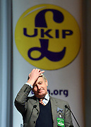 © Licensed to London News Pictures. 23/03/2013. Exeter, UK . Former Conservative MP Neil Hamilton delivers a speech to conference.  The UK Independence Party (UKIP) 2013 Spring Conference is held at the Great Hall, Exeter University today, Saturday 23rd March 2013. Support for the party is rising after success in the recent Eastleigh by-election, where UKIP came second behind the Liberal Democrats. Photo credit : Stephen Simpson/LNP