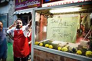 Napoli, Italia - 6 luglio 2010. Circa 500 abitanti (nella foto un commerciante) del quartiere di Secondigliano (Scampia) hanno partecipato ad una fiaccolata per manifestare il loro dissenso nei confronti del trasferimento del prete anti-camorra don Aniello Manganiello..Ph. Roberto Salomone Ag. Controluce.ITALY - 500 residents of Secondigliano district in Naples took part to the torch rally to protest against the decision to remove anti-camorra mafia organisation priest don Aniello Manganiello from his church in the Secondigliano district on July 6, 2010.