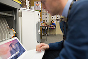 Matt Townsley, Director of Instruction and Technology at Solon Community Schools in Solon, Iowa, checks on a MacBook Air cart at Lakeview Elementary School on Tuesday, March 8, 2016.