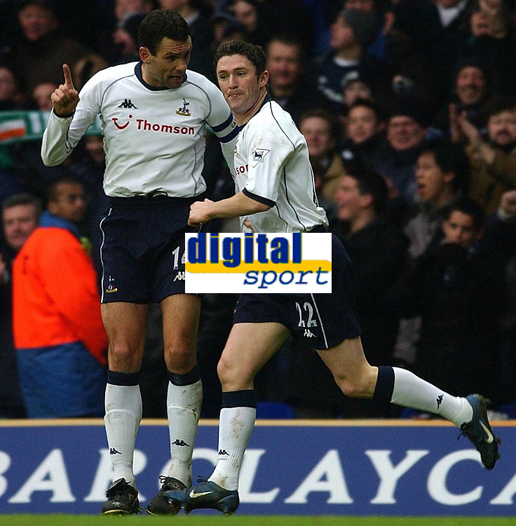 Fotball - Premier League - 12.10.2003<br /> Tottenham v Everton<br /> Gus Poyet og Robbie Keane - Tottenham<br /> Foto: Javier Garcia, Digitalsport