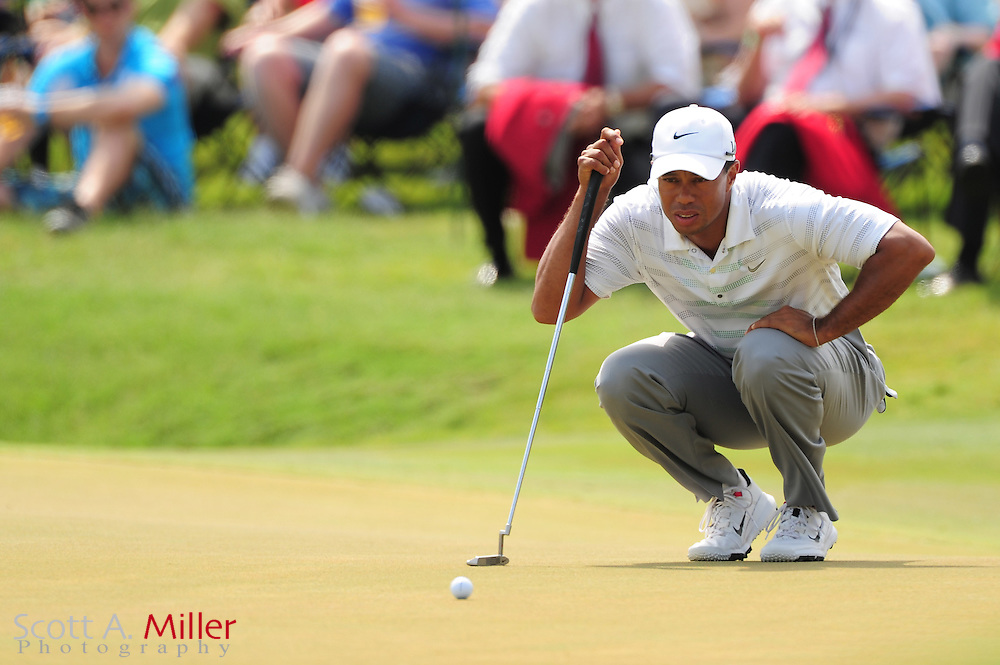 Tiger Woods putts on the 18th green during the third round of the Players Championship at the TPC Sawgrass on May 12, 2012 in Ponte Vedra, Fla. ..©2012 Scott A. Miller..