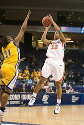 Virginia guard Monica Wright (22) shoots a jump shot over UCSB guard Meagan Williams (21).  The #4 seed/#24 ranked Virginia Cavaliers defeated the #13 seed Santa Barbara Gauchos 86-52 in the first round of the 2008 NCAA Division 1 Women's Basketball Championship at the Ted Constant Convocation Center in Norfolk, VA on March 23, 2008