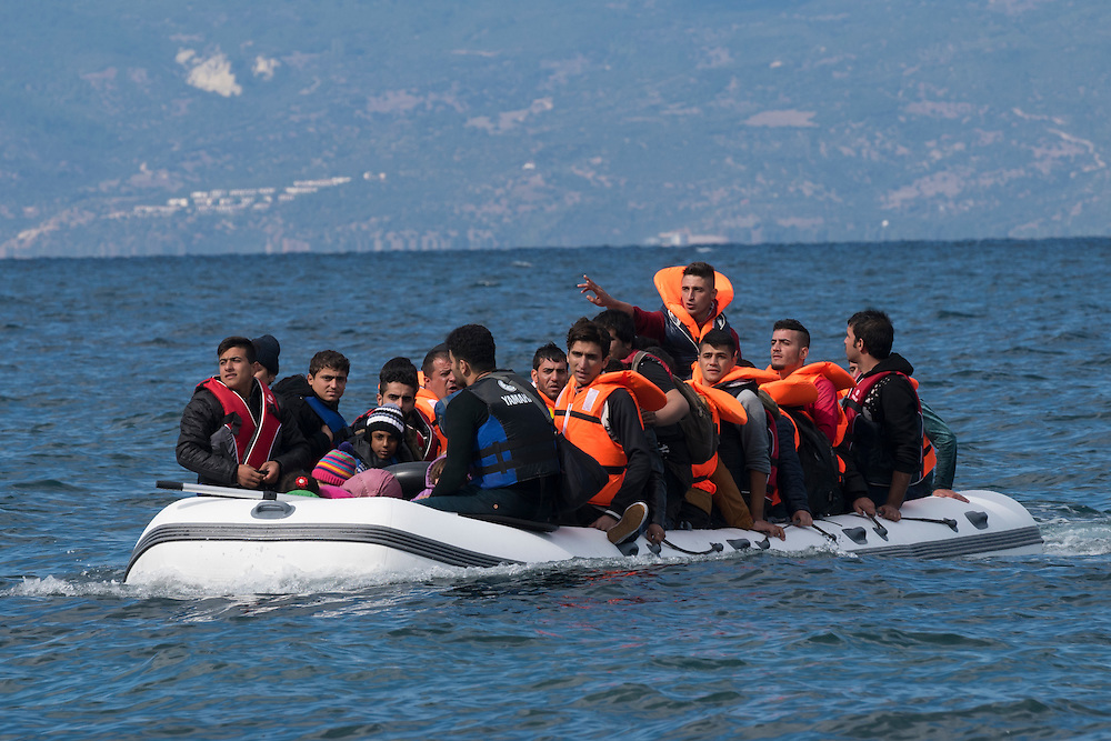 An inflatable boat filled with refugees and other migrants approaches the north coast of the Greek island of Lesbos. Turkey is visible in the background. More than 500,000 migrants have crossed from Turkey to the Greek islands so far in 2015.