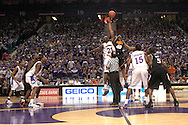 Kansas State's Dramane Diarra (21) and Oklahoma State's Kenny Cooper (40) take the opening tip at Bramlage Coliseum in Manhattan, Kansas, February 4, 2006.  The Cowboys defeated K-State 63-61.