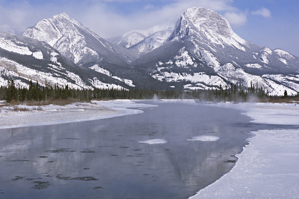 Mist rising from the Athabasca River on a cold winter morning in Jasper National Park, Alberta, Canada.