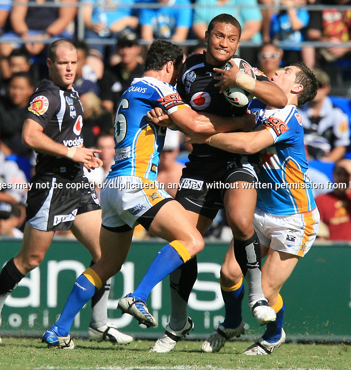 Manu Vatuvei attempts to bust his way through the Titans defense during round 7 of the NRL - Gold Coast Titans v New Zealand Warriors. Played at Skilled Stadium, Robina QLD. Titans (36) defeated the Warriors (24).  Photo: Warren Keir (Photosport NZ).<br /> <br /> Use information: This image is intended for Editorial use only (e.g. news or commentary, print or electronic). Any commercial or promotional use requires additional clearance.