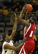 21 JANUARY 2009: Wisconsin's Marcus Landry (1) puts up a shot over Iowa's David Palmer (2) during the first half of an NCAA college basketball game Wednesday, Jan. 21, 2009, at Carver-Hawkeye Arena in Iowa City, Iowa. Iowa defeated Wisconsin 73-69 in overtime.